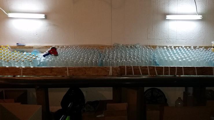 7 tys. litrów spirytusu bez akcyzy. Zlikwidowano nielegalną rozlewnię alkoholu