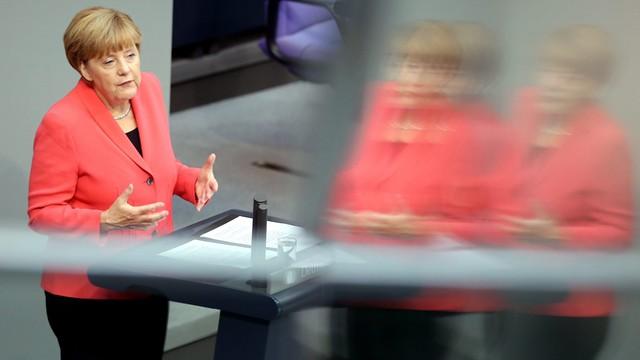 Merkel za stałym systemem rozdziału uchodźców w UE
