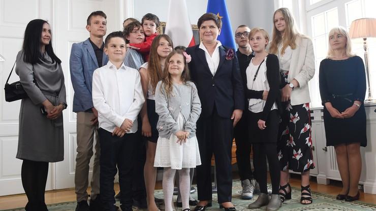 """""""Zachęcam, wracajcie"""". Premier na spotkaniu z Polonią"""